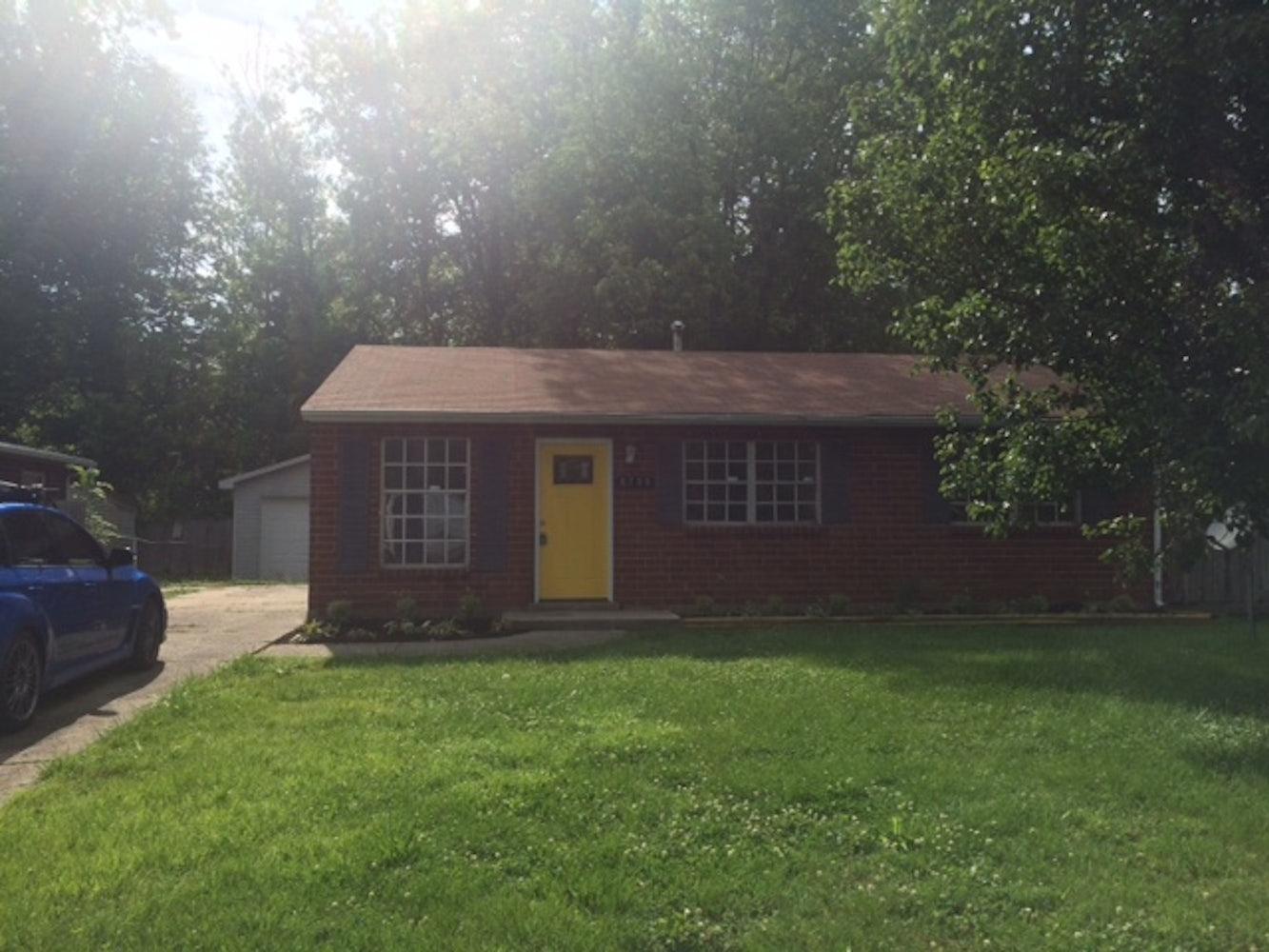 Brick 4 bedroom, 1 bath, 2 car detached garage NO SECTION 8