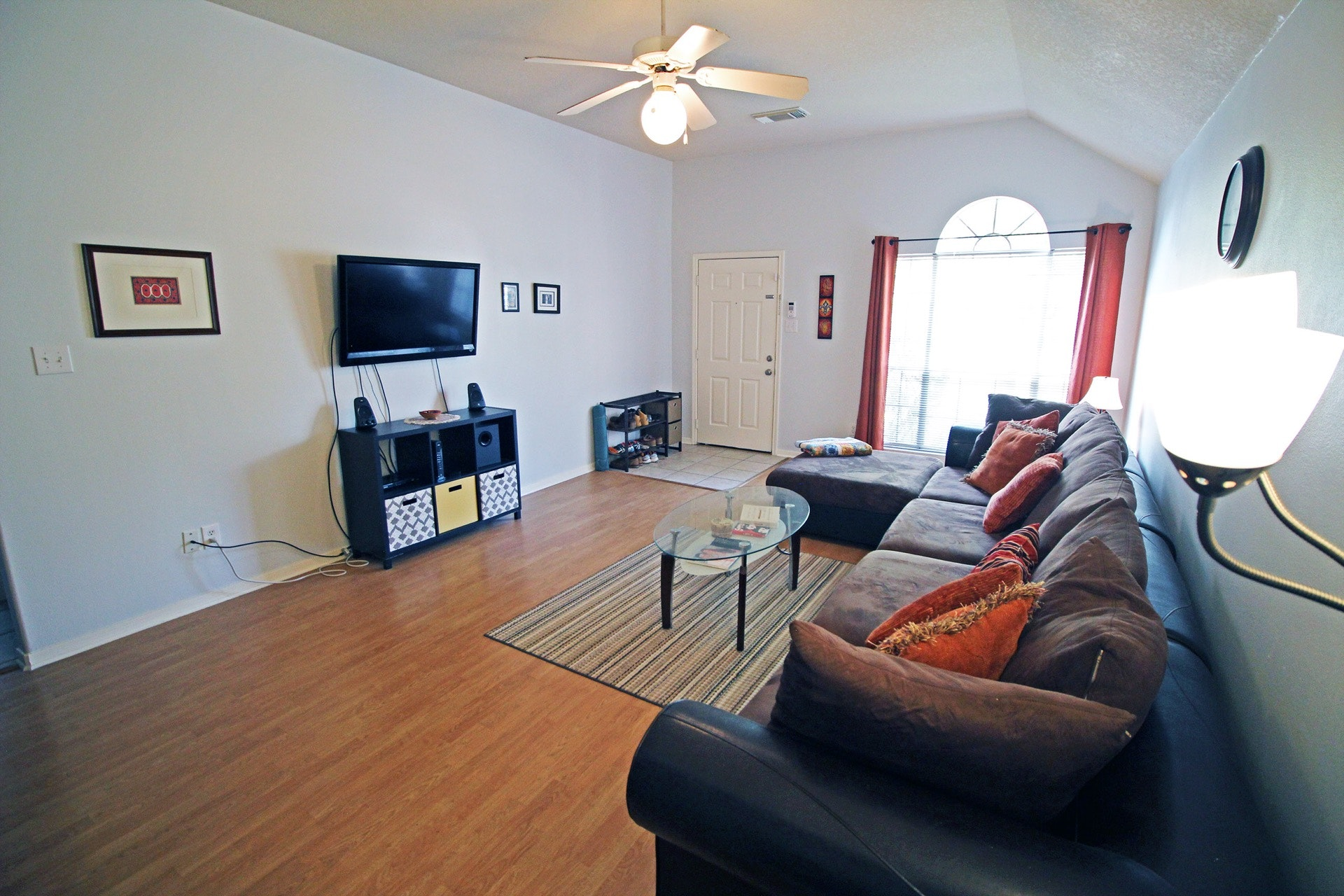 Large Living Room With High Ceilings And Laminate Wood Floors. (House Does  Not Come